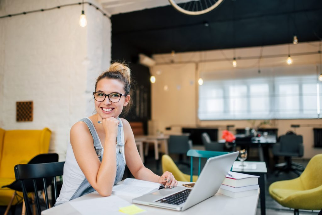 Portrait of smiling entrepreneur girl indoors.